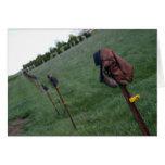 Bota de vaquero vieja en el poste de la cerca felicitación