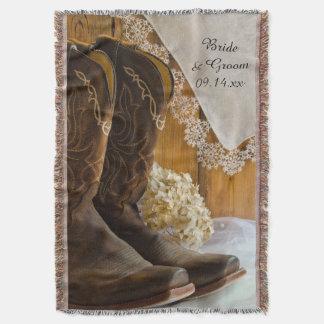 Botas de vaquero y tiro del boda del país del manta