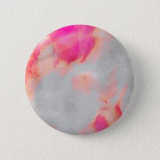 Botón anaranjado rosado del lavado
