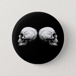 Botón blanco y negro del cráneo del perfil
