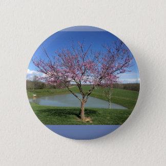 Botón con la imagen hermosa del árbol floreciente