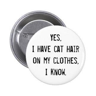 Botón de la conciencia del pelo del gato