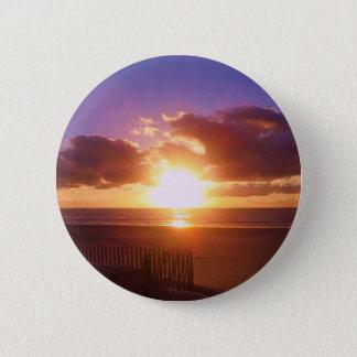 Botón de la salida del sol de la playa