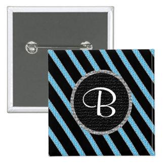 Botón del monograma del azul y de las rayas negras pins