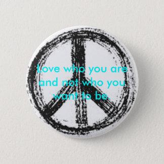 Botón del signo de la paz con cita linda