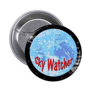 Botón del vigilante del cielo