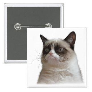 Botón gruñón del resplandor del gato