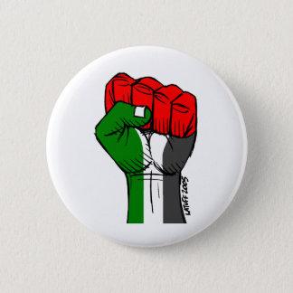 Botón palestino del puño de Carlos Latuff