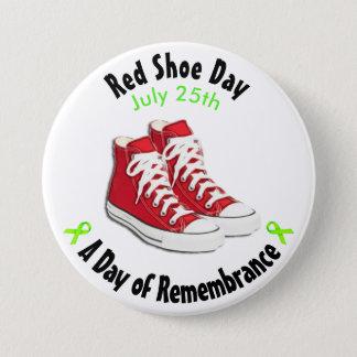 Botón rojo de los zapatos del día rojo del zapato