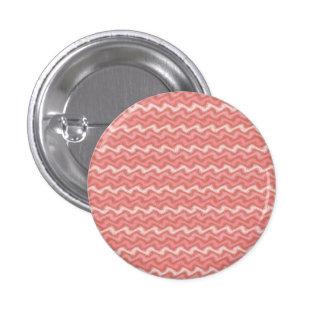 Botón rosado ondulado