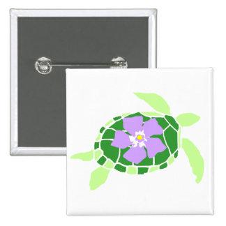Botón violeta de la tortuga de mar de la flor