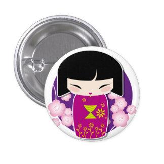 Botón violeta del kokeshi