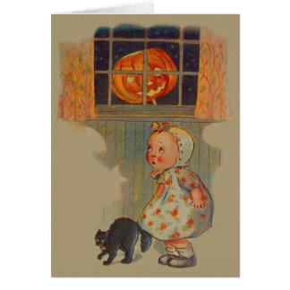 Broma asustada del gato negro de la linterna de tarjeta de felicitación