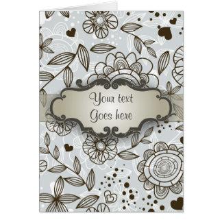 Brown en floral azul con el letrero tarjeta de felicitación
