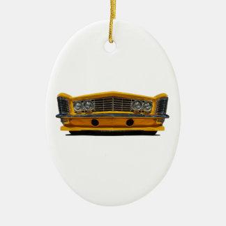 Buick amarillo adorno navideño ovalado de cerámica