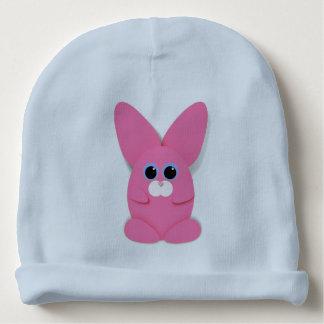 Bunn rosado en un gorra del bebé azul gorrito para bebe