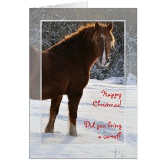Caballo en la tarjeta de Navidad de la nieve