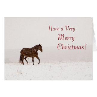 Caballo en tarjeta de las Felices Navidad de la