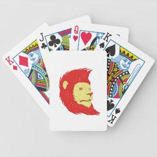 Cabeza del león con el dibujo de la melena que baraja de cartas bicycle