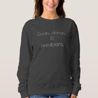 Cabras, anillos de espuma y camiseta de los