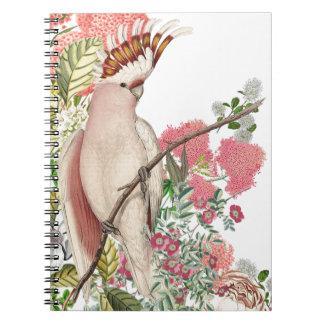 Cacatúa rosa,sobre manto de flores libro de apuntes