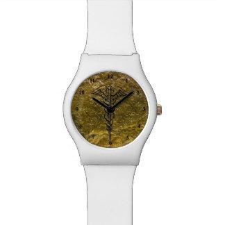 Caduceo de cuidado médico del reloj el   de la
