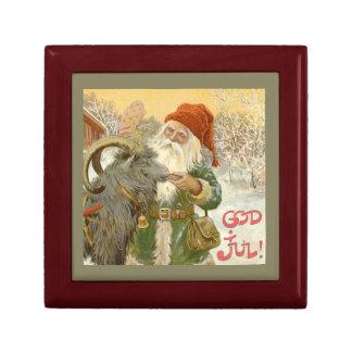 Caja De Regalo Jultomten alimenta a cabra de Yule una galleta