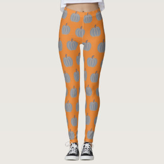 Calabazas decorativas de los gris plateados en las leggings