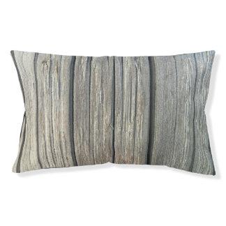 Cama de madera ligera del perro de la textura