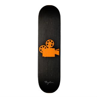 Cámara de película anaranjada patines
