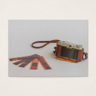 cámara vieja con la tarjeta de visita negativa