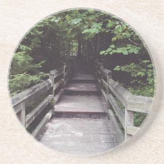 camine en las maderas posavasos