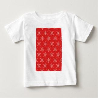 Camiseta De Bebé Modelo inconsútil con los copos de nieve. Fondo