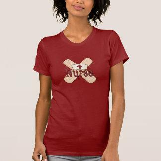 Camiseta del dibujo animado del vendaje de la