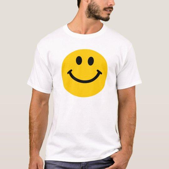 Camiseta sonriente feliz amarilla de la cara