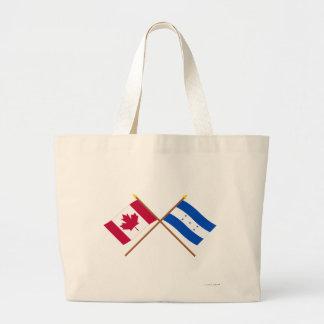 Canadá y banderas cruzadas Honduras Bolsas De Mano