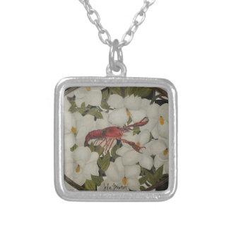Cangrejos de Luisiana y collar de la magnolia