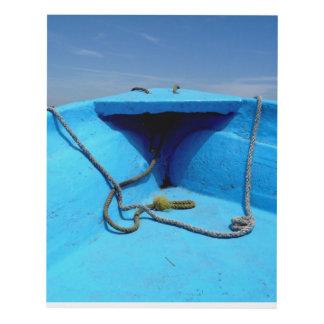 Canoa azul con la cuerda cuadro