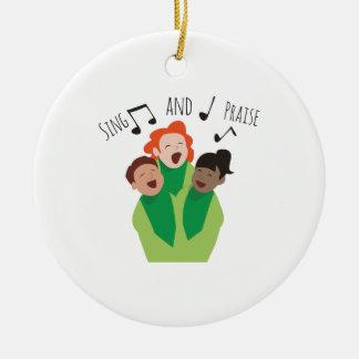 Cante y elogie adorno navideño redondo de cerámica
