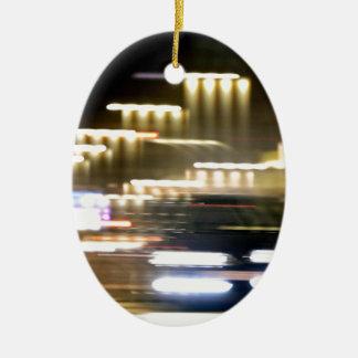 Car in street in urban city lights with distortion adorno navideño ovalado de cerámica