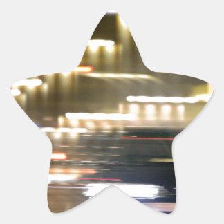 Car in street in urban city lights with distortion pegatina en forma de estrella
