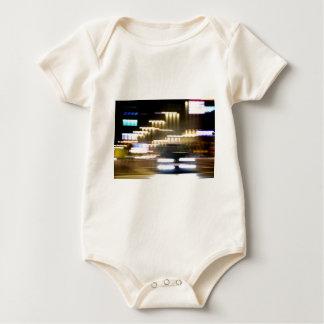 Car in street in urban city lights with distortion peleles de bebé