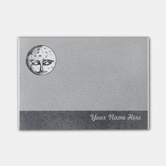 Cara de luna el dormir en nota de post-it gris