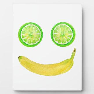 Cara del smiley de la fruta de la acuarela placa expositora