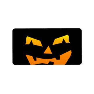 Cara fantasmagórica de la calabaza de Halloween de Etiquetas De Dirección