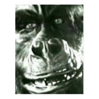 Cara grande del mono postal