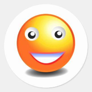 Cara sonriente anaranjada y amarilla etiquetas redondas