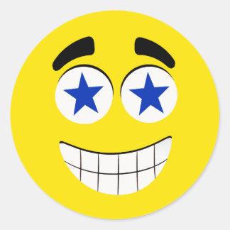 Cara sonriente con los ojos estrellados pegatina redonda