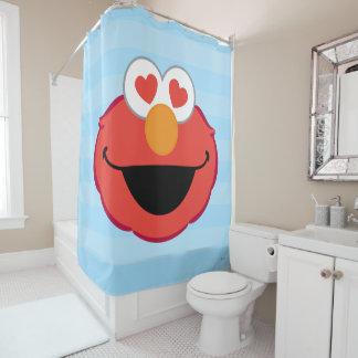 Cara sonriente de Elmo con los ojos en forma de
