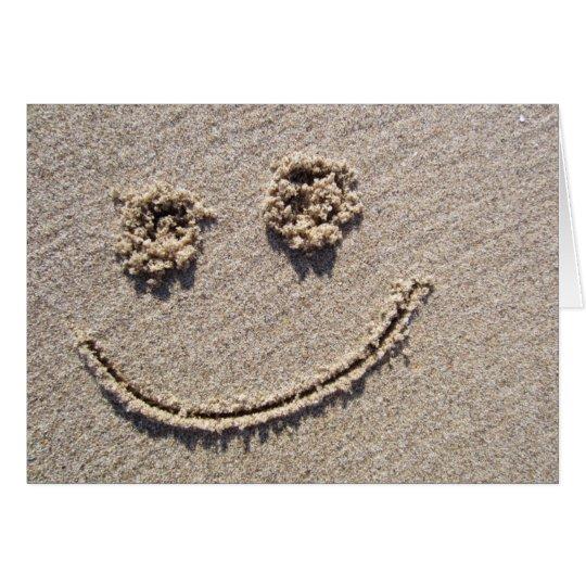 Cara sonriente en la tarjeta de felicitación de la